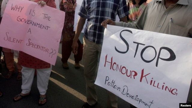 "FILE - Human rights activists in Islamabad stage a rally against ""honor killings."""