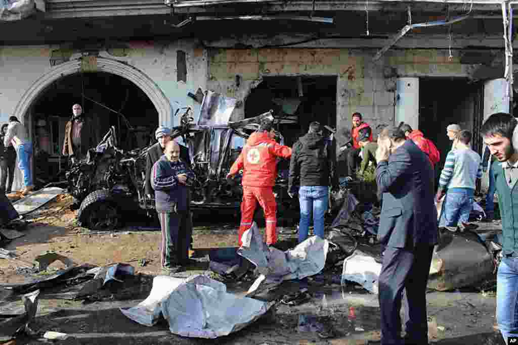 People gather at the site of a car bomb explosion in Hermel, northeast of Lebanon, Jan. 16, 2014.