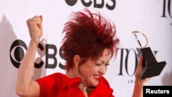 Cyndi Lauper celebrates with her award for Best Original Score at the 67th Annual Tony Awards. REUTERS/Carlo Allegri
