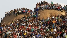 Mining community gathers at a hill dubbed the 'Hill of Horror' during a memorial service for miners killed during clashes at Lonmin's Marikana platinum mine in Rustenburg, 100 kilometers northwest of Johannesburg, South Africa, August 23, 2012.