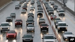 Drivers make their way in the rain along Interstate Highway 95 in Miami, Aug. 30, 2016. Forecasters at the National Hurricane Center in Miami say Tropical Storm Hermine is on a track that would approach the northwest Florida coast Thursday afternoon.
