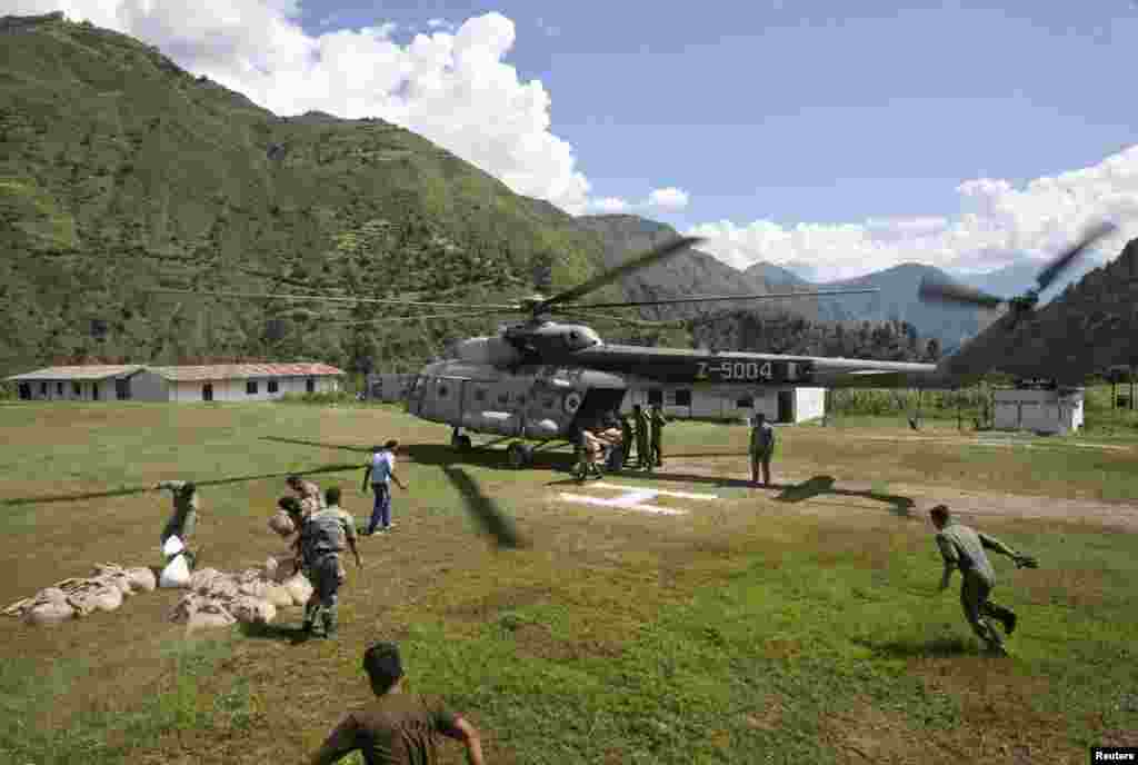 Army soldiers stacking relief materials at an army camp near Reasi, northwest of Jammu, Sept. 9, 2014.