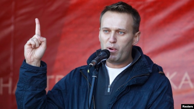 FILE - Russian lawyer and blogger Alexei Navalny attends a rally in Moscow, Oct. 22, 2011.