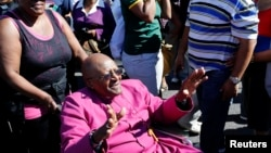 FILE - Archbishop Emeritus Desmond Tutu waves to well-wishers in Cape Town, April 19, 2014.