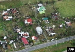 An aerial photo shows houses destroyed at the height of Typhoon Mangkhut in Alcalá, in Cagayan province, Sept. 16, 2018. Mangkhut slammed into the northern Philippines with violent winds and torrential rains, as authorities warned millions in its path.