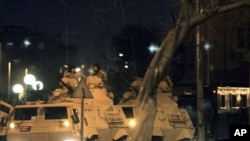 Egyptian army armored vehicles patrol a street in Cairo following protests in Cairo, Egypt, Jan 28, 2011
