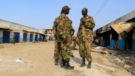 South Sudan army soldiers talk to each other in Malakal town, 497km (308 miles) northeast of Juba, Dec. 30, 2013.