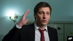 FILE - Russian opposition lawmaker Dmitry Gudkov speaks to the media in Moscow, March 14, 2013.