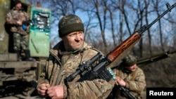 FILE - Members of the Ukrainian armed forces are seen near Artemivsk, eastern Ukraine, Feb. 23, 2015.