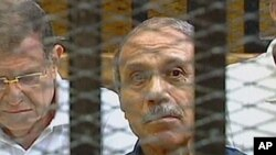 Egyptian former interior minister Habib al-Adly sits in a holding cell in the Cairo Criminal Court on the outskirts of the capital, on the first day of the trial of the ousted Egyptian president where he is to face murder charges, August 3, 2011.