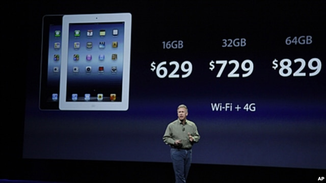 Apple's senior vice president of Worldwide Marketing Phil Schiller discusses the prices of the new iPad during an event in San Francisco, March 7, 2012.