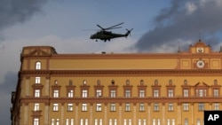 Russian military Mi-35 helicopter takes off from the building of the Federal Security Service (FSB, Soviet KGB successor) in Lubyanskaya Square in Moscow, Russia.
