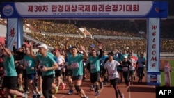 Foreign competitors cross the starting line during the annual 'Mangyongdae Prize International Marathon', at Kim Il Sung stadium in Pyongyang, North Korea, April 7, 2019.