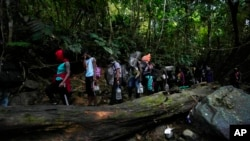 Migrants, mostly Haitians, trek north on their way to crossing the Darien Gap, near Acandi, Colombia, Sept. 15, 2021.