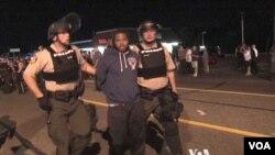Police make an arrest in Ferguson, Missouri, Aug. 10, 2015. (Photo: Kane Farabaugh / VOA)