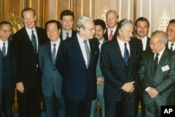 Foreign ministers attending the Paris Peace Conference on Cambodia pose prior to the meeting, Oct. 23, 1991. Front row L-R: United Nations Secretary General Javier Perez de Cuellar, Roland Dumas of France, Cambodia's Prince Norodom Sihanouk, back row L-R: unidentified, U.S. Secretary of State James Baker, Qian Qichen of China, Soviet Union's Boris Pankin, Burnei's Prince Mohamed Bolkiah, Great Britain's Lord Caithness, unidentified, Thailand's Anan Sarasin. (AP Photo)