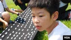 主動參與學民思潮反對國民教育活動的12歲升讀中學一年級學生劉焌朗