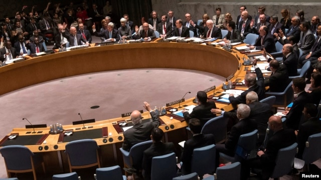 Members of the United Nations Security Council vote unanimously to approve a resolution eradicating Syria's chemical arsenal at a meeting during the 68th United Nations General Assembly in New York on Sep. 27, 2013.
