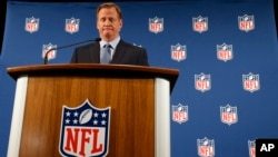 NFL Commissioner Roger Goodell pauses as he speaks during a news conference in New York, Sept. 19, 2014.