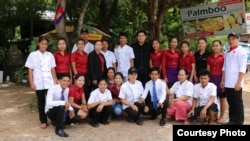 Luon Anchamnes with his employees in front of his Palmboo restaurant in Siem Reap. (Courtesy Photo)