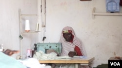 Falmata Mustapha received a sewing machine from Hajia Hawa. She's been able to earn some money as a tailor to support her children, Maiduguri, Nigeria, Sept. 2016. (Photo: C. Oduah)