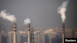 Smoking chimneys near residential buildings in Tianjin, China. Air pollution sometimes covers parts of the country at dangerous levels.