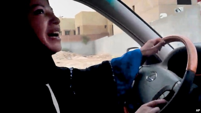 File - Saudi Arabian woman drives car as part of campaign to defy Saudi Arabia's ban on women driving, Riyadh.
