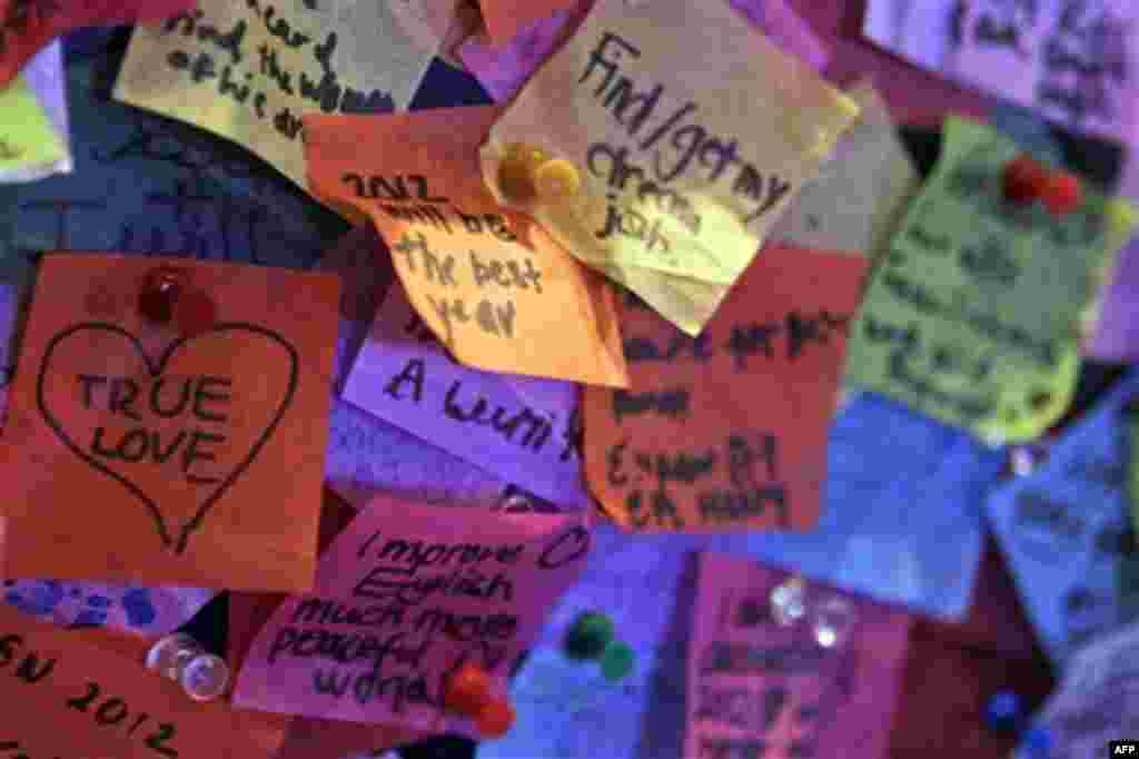 Wishes for 2012 written on confetti that will be released in New York's Times Square during the New Year celebration are on display at the Times Square visitor center, Thursday, Dec. 29, 2011 in New York. The Times Square Alliance conducted it's airworthi