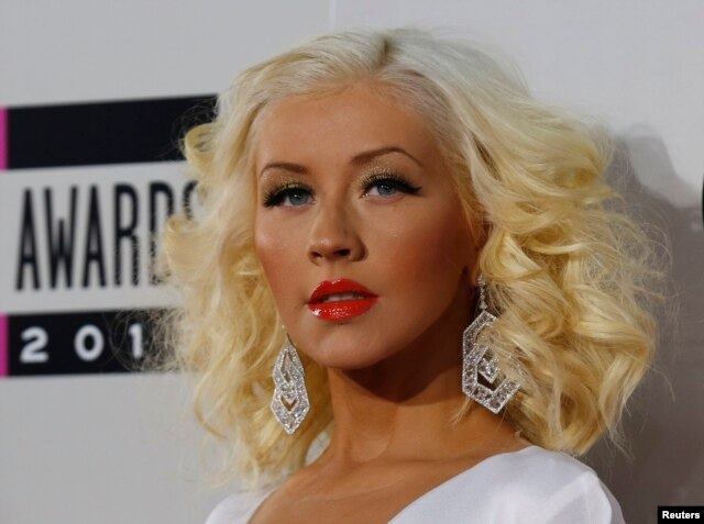 Musician Christina Aguilera arrives at the 41st American Music Awards in Los Angeles, California Nov. 24, 2013.