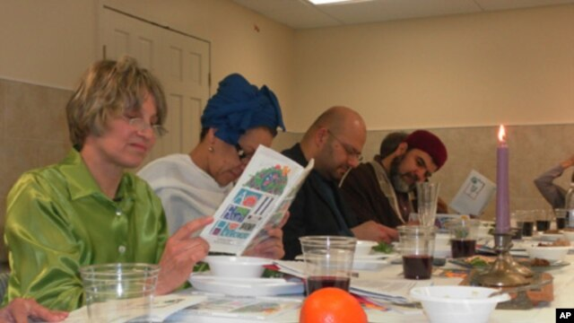 Andrea Barron (left) and Rizwan Jaka (second from right) join others in  reading from the Haggadah, a Jewish text which outlines the order of the Passover Seder.