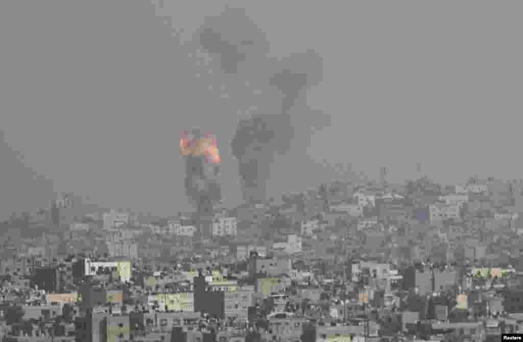 An explosion and smoke are seen after an Israeli strike in Gaza November 15