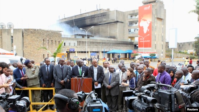Kenya Airways and government officials address a joint news conference after a huge fire left all flights suspended at the Jomo Kenyatta International Airport, in Kenya's capital, Nairobi, Aug. 7, 2013.