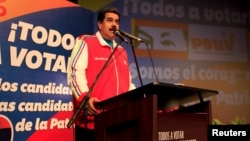 Venezuela's President Nicolas Maduro speaks during a rally with candidates of United Socialist Party (PSUV) in Caracas, June 22, 2015, in this handout picture.