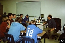 Teacher Michael Bair emphasizes teamwork, reading, writing, computer skills and public speaking in his 9th grade English class for boys.