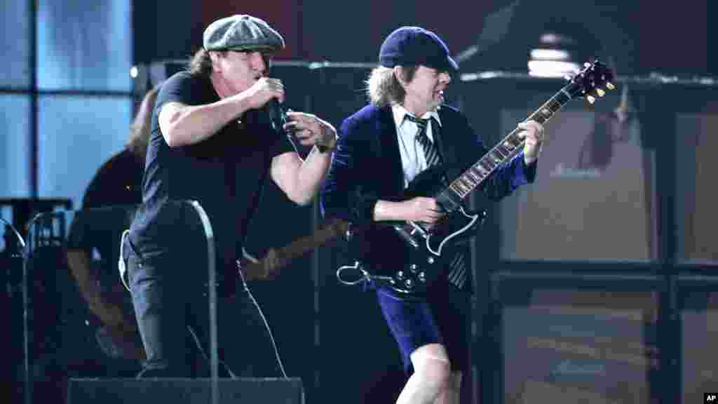 Brian Johnson, left, and Angus Young of AC/DC perform at the start of the 57th annual Grammy Awards in Los Angeles, California, Feb. 8, 2015.