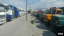 In this photo sent to VOA Persian, Iranian trucks idled by a 4-day-old truckers strike can be seen in the northern province of Qazvin, Sept. 26, 2018. (VOA)
