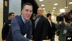 Republican presidential candidate Mitt Romney greets supporters at a caucus, in Portland, Maine, February 11, 2012.