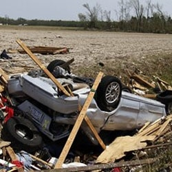 A car sits in a drainage ditch in Colerain, North Carolina, after a tornado ripped through the area Saturday