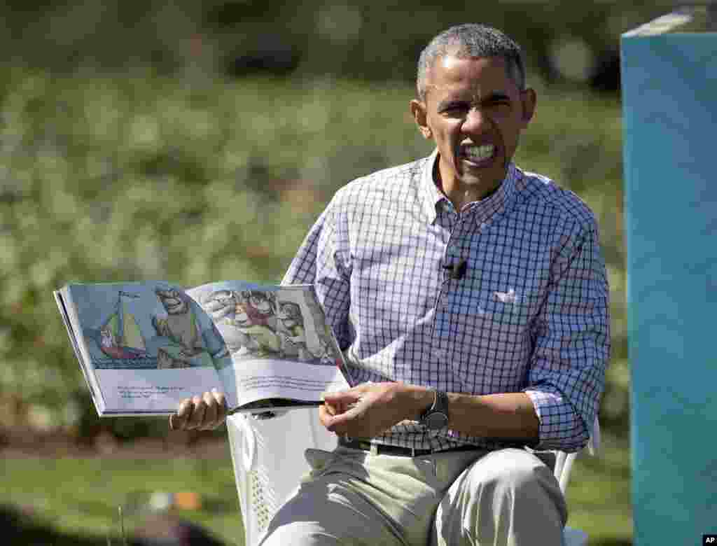 "President Barack Obama makes a face as he reads ""Where the Wild Things Are"" by Maurice Sendak, during the White House Easter Egg Roll on the South Lawn of the White House in Washington, D.C. Thousands of children gathered at the White House for the annual Easter Egg Roll."