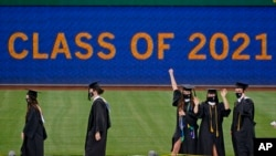University of Pittsburgh candidates for graduation line up to receive their diplomas during a ceremony in Pittsburgh, Tuesday, May 4, 2021. (AP Photo/Gene J. Puskar)