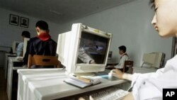 A North Korean teenager learns to use a computer which displays an image of western fighter jets at the Kumsong School, a performing arts and IT-specialist school in Pyongyang, North Korea (FILE).