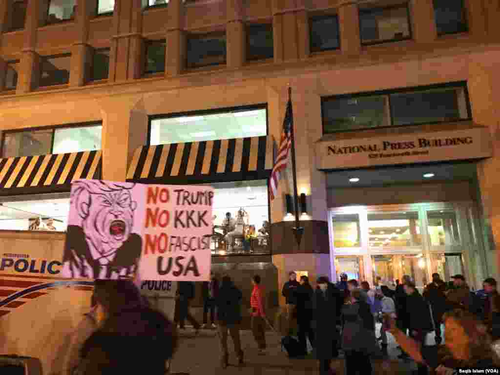 Protesters outside the National Press Club in Washington, D.C., hold signs saying No Trump, No KKK, No Fascist USA on the eve of the inauguration of President-elect Donald Trump, Jan. 19, 2017.