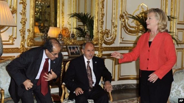 """U.S. Secretary of State Hillary Clinton (R), Mustafa Abdel Jalil, chairman of the Libyan National Transitional Council (NTC), and Mahmoud Jibril, the head of Libya's rebel National Transitional Council, attend a bilateral meeting ahead of the """"Friends of"""