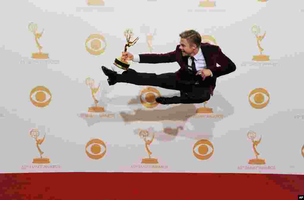 Derek Hough poses backstage with the award for outstanding choreography for his work on 'Dancing with the Stars' at the 65th Primetime Emmy Awards at the Nokia Theatre in Los Angeles, Sept. 22, 2013.