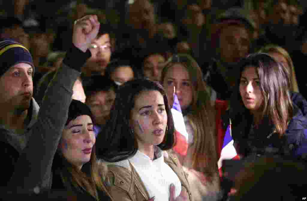 People gather and sing the French national anthem at a vigil in a tribute to the victims of the Bastille Day attack, in Sydney, Australia, July 15, 2016.