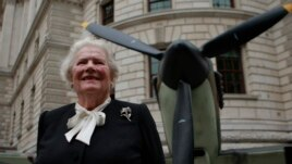 FILE - Lady Mary Soames, daughter of WWII-era British Prime Minister Winston Churchill, poses for a picture against the backdrop of a Spitfire fighter plane in London, Aug. 20, 2010.