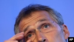 Norway's Prime Minister Jens Stoltenberg adjusts his glasses during a press conference in Oslo, Norway, Wednesday, July 27, 2011.