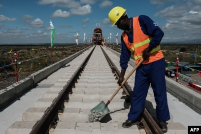 FILE - A Kenyan worker lays gravel at a construction site for the Standard Gauge Railway (SGR) in Nairobi, Kenya, June 23, 2018.