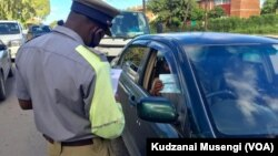 Zimbabwe police manning a roadblock during the COVID-19 lockdown.