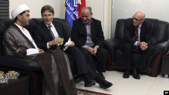 In a photo released by Bahraini opposition group, Al Wifaq, U.S. Assistant Secretary of State for Democracy, Human Rights and Labor Tom Malinowski, second left, visits with Sheikh Ali Salman, head of Wifaq National Islamic Society, left, former member of  Bahraini parliament, Abdul Jalil Khalil, second right, Timothy J. Pounds, U.S. Deputy Chief of Missionin Bahrain, right, in Manama, July 6, 2014.